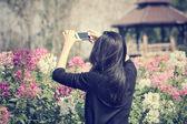 Woman take a photo wiht smart phone — Stock Photo