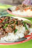 Rice topped with fried pork and basil — Stock Photo