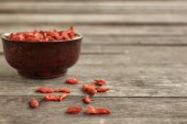 Dried goji berries on wood background — Stock Photo