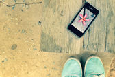 Selfie of smart phone with sneakers — Stock Photo