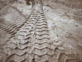 Wheel tracks on the soil. — Stock Photo
