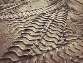 Wheel tracks on the soil. — Stock Photo