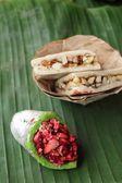 Indian sweets on banana leaf — Stock Photo