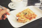 Italian lasagna with coffee cup — Stock Photo