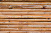 Brown wood log wall background — Stock Photo