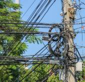 Messy electric cables on pole in Thailand — Stock Photo