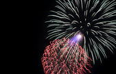 Colorful fireworks in the black sky — Stock Photo