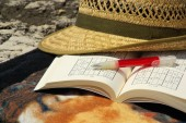 Sudoku with hat and pen on table — Stock Photo