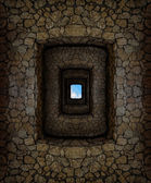 Dungeon with stone walls and light window high above — Stock Photo