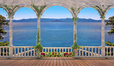 Terrace with balustrade overlooking the sea and mountains — Stock Photo