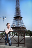 Boy on a background copy of the Eiffel Tower — Stock Photo