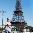 Boy on a background copy of the Eiffel Tower — Stock Photo #59176393