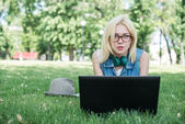 Mixed race college student sitting — Stock Photo