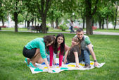 Students play a game in the park twister — Stock Photo