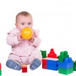 Child boy playing with block toys over white background — Stock Photo #65528023