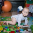 Side view of pretty crawling baby — Stock Photo #66256771