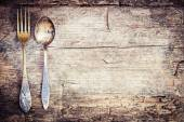 Vintage silverware on wooden background — Stock Photo