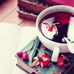Rosehip tea on old books — Stock Photo #57765725