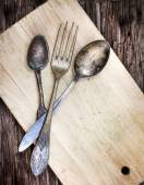 Vintage silverware on wooden background — Stock Photo