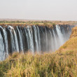 Постер, плакат: Panoramic view of Victoria Falls with toruists in Zimbabwe