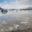 Glacier lake and mountains in iceland, cloudy sky — Stock Photo #63454061