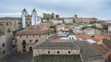 Time Lapse of Caceres down town with tourists at sunset, top view — 图库视频影像