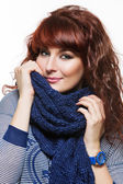 Woman with knitted wool scarf — Stock Photo