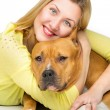 Woman hugging her dog — Stock Photo #65980453