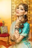 Beautiful girl in oriental costume — Stock Photo