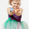 Little girl with Easter eggs in hands — Stock Photo #69657403
