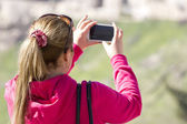 Woman taking photograph with smartphone at enjoying view of Jerusalem — Stock Photo