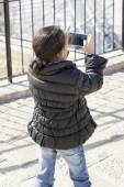 Little girl making video or photo with mobile phone. — Stock Photo