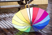 Colorful umbrella outdoors at autumn rainy day — Stock Photo