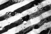 Black and white diagonal stripes background — Stockfoto