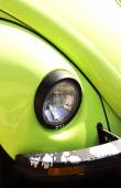 Color detail on the headlight of a vintage modern car — Stock Photo