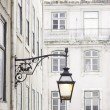 Old street lamp on a classical facade in Lisbon — Stock Photo #55948949