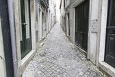 Old and historic alley in Lisbon — Stock Photo