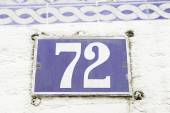 Number seventy-two on a wall — Foto de Stock