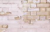 Brick Wall battered and abandoned — Stock Photo