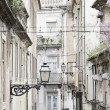 Old street lamp on a classical facade in Lisbon — Stock Photo #62575371