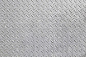Rugged metal relief background — Stock Photo