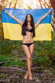 Woman with ukrainian flag — Stock Photo