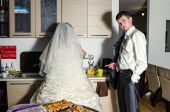 Newly-married couple in the kitchen — Stock Photo
