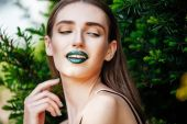 Woman with green lipstick — Stock Photo