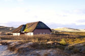 Rieten dak huis — Stockfoto