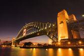 Harbour bridge - Night city skyline — Stock Photo