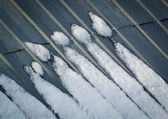 Snow on the roof figurines — Stock Photo