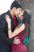 Young Happy Indian Couple Kissing — Стоковое фото