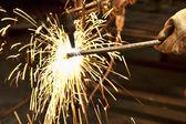 A metal fabricator utilizing a torch — Stock Photo