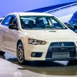 Постер, плакат: MOSCOW RUSSIA AUG 2012: MITSUBISHI LANCER EVOLUTION X presented as world premiere at the 16th MIAS Moscow International Automobile Salon on August 30 2012 in Moscow Russia